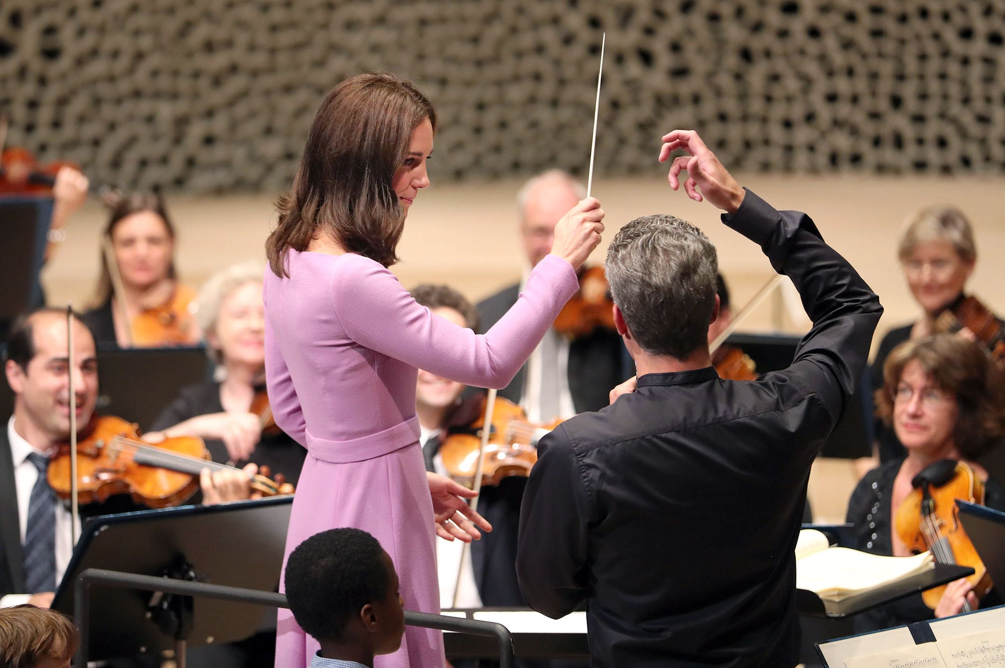 HAMBURG, GERMANY - JULY 21: Catherine, Duchess of Cambridge receives lessons to conduct an orchestra at Elbphilharmonie during day three of their official visit to Germany after two days in Poland on July 21, 2017 in Hamburg, Germany. (Photo by Jane Barlow - Pool/Getty Images)