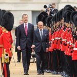 King Felipe and the Duke of Edinburgh inspect the Guard of Honour on Horse Guards Parade before boarding the Royal carriages to travel to Buckingham Palace