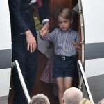 Like father like son Prince George pictured left arriving in Warsaw today may well have reminded royal fans of his father Prince William Photo C GETTY IMAGES
