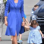 Mother and daughter were sweetly co ordinated in blue outfits for their journey to Berlin this morning