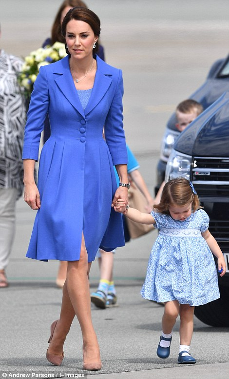 Kate looked glowing in a blue three quarter sleeve coat by Catherine Walker Co