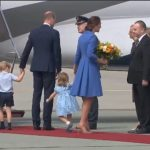 No time to waste Princess Charlotte wasnt having any of it as her mother paused to chat as she received a bouquet of flowers before leaving Warsaw