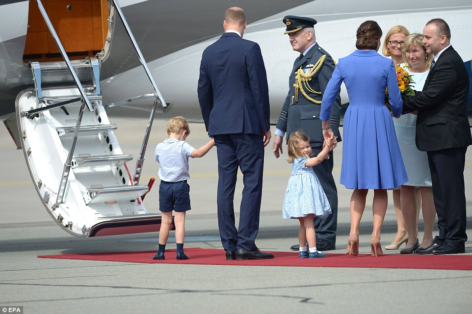 No time to waste! Princess Charlotte wasn't having any of it as she tugged on her mother's hand while she paused to chat as she received a bouquet of flowers before leaving Warsaw
