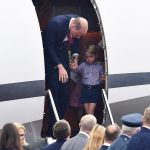 Not ready for his big moment Shy George needed a little encouragement from his father as they prepared to disembark