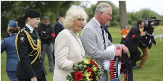 Prince Charles and Camilla Duchess of Cornwall walk with wreaths to be placed at the Afghanistan Memorial Friday June 30 2017