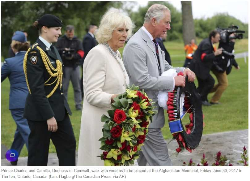 Prince Charles and Camilla, Duchess of Cornwall ,walk with wreaths to be placed at the Afghanistan Memorial, Friday June 30, 2017