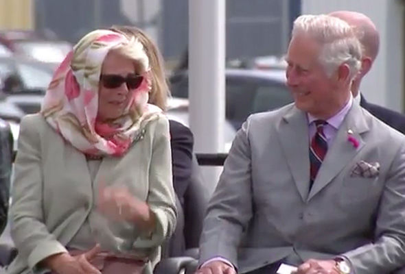 Prince Charles and Camilla are unable to control their laughter during the performance Photo (C) NC