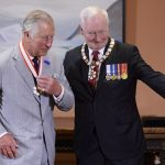 Prince Charles left receives the Extraordinary Companion to the Order of Canada medal from Governor General David Johnston at Rideau Hall in Ottawa