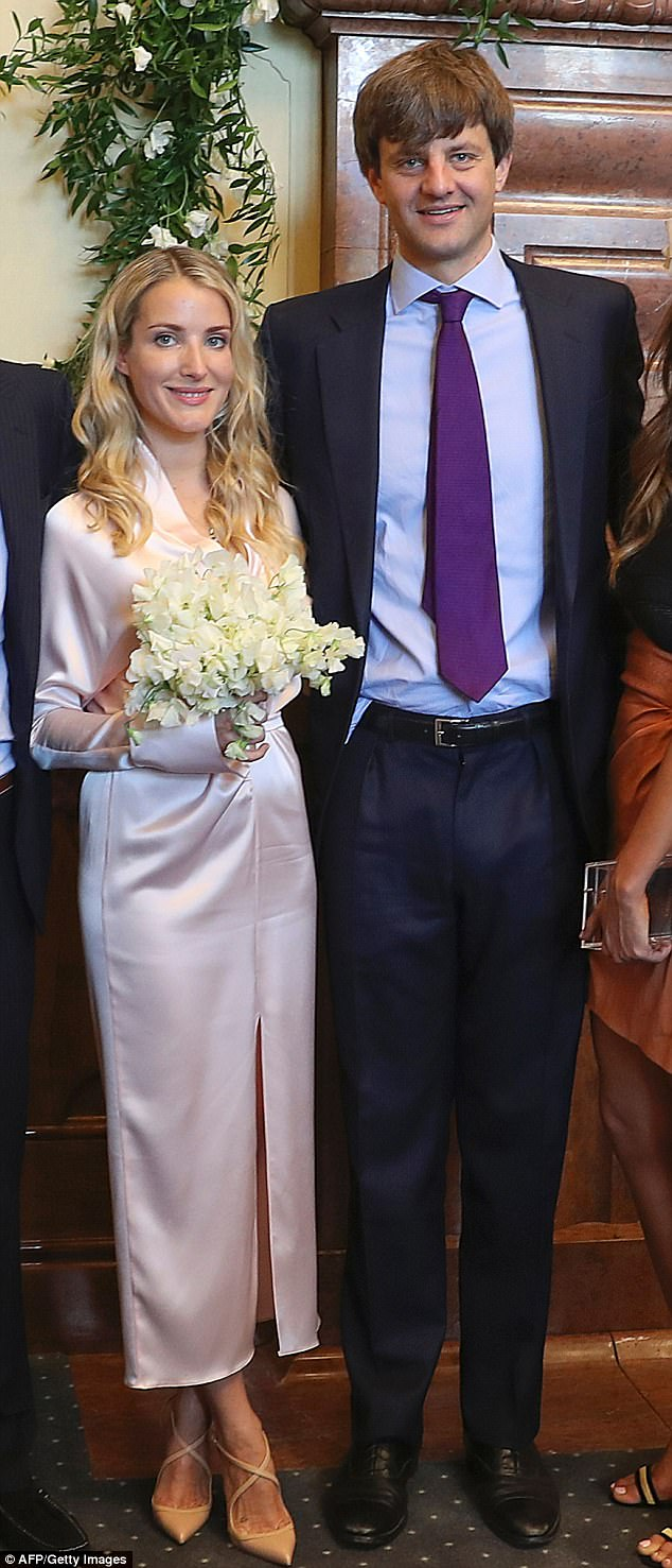 Prince Ernst August of Hanover, right, and Russian fashion designer Ekaterina Malysheva, left, tied the knot in a simple civil ceremony in Hanover City Hall on Thursday