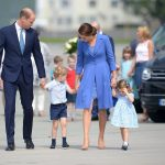 Prince George was wearing his trademark navy shorts teamed with a pale blue shirt while his sister was in a matching colour scheme