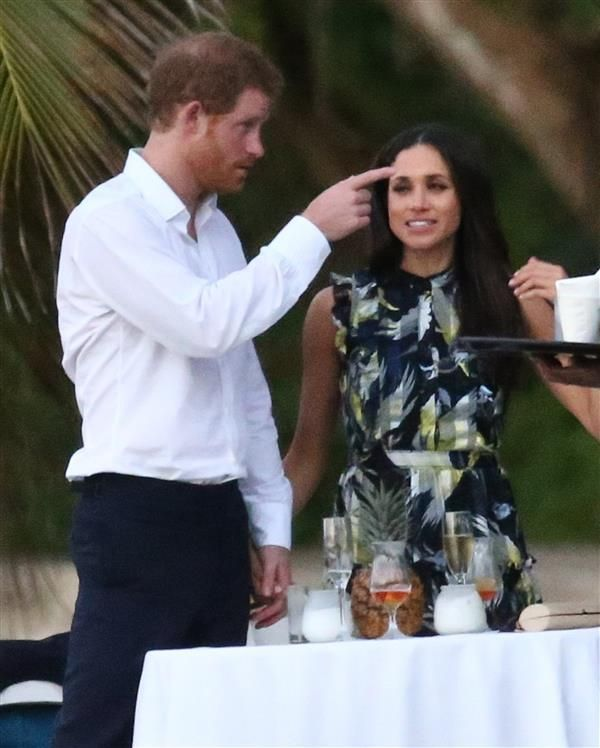 Prince Harry and Meghan Markle pack on the PDA during a pal's Jamaican wedding
