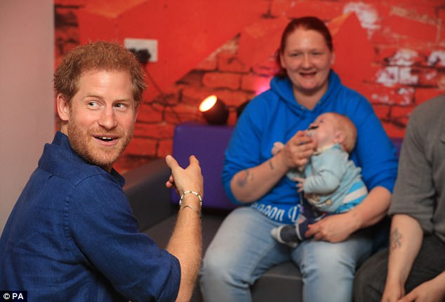 Prince Harry meets Lewis Maloy and his mother KerryAnne Rhodes during a visit to Leeds Children's Hospital, on the second day of his two-day visit to the city