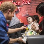 Prince Harry meets Mareyah Joseph Webster and her mother Sonya Joseph during a visit to Leeds Childrens Hospital