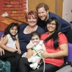Prince Harry meets Mareyah Joseph Webster centre her mother Sonya Joseph sister Tayah Mai Webster and grandmother Patricia Smith during a visit to Leeds Childrens Hospital