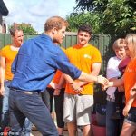Prince Harry met volunteers from the WellChild programme pictured who are transforming Olivers garden into a safe space to play