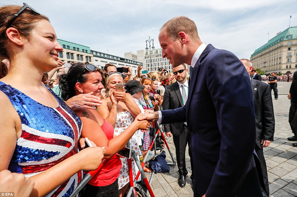 Prince William, Duke of Cambridge greets members of the public gathered at the Pariser Platz as royal fever sweeps Berlin