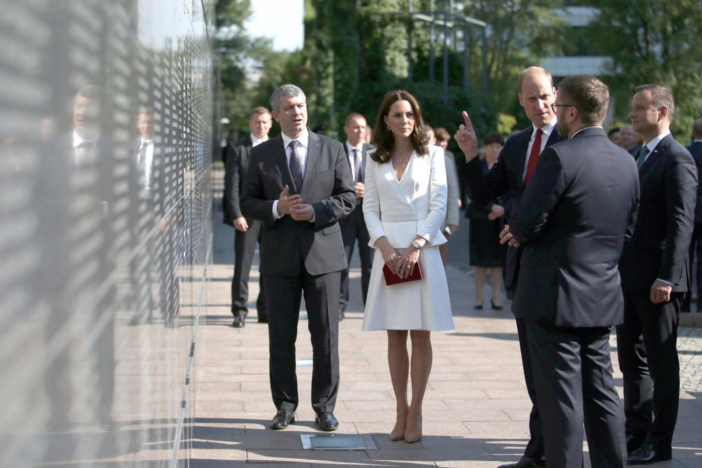 Prince William and Kate pay their respects at the Wall of Remembrance in Warsaw Getty Images