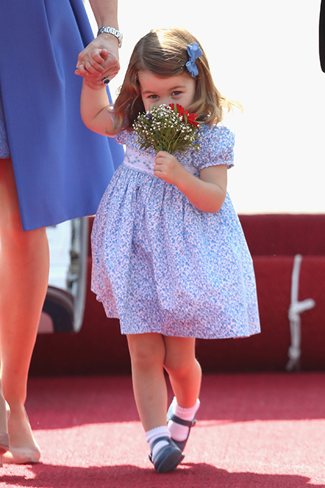 Princess Charlotte looked delighted with her flowers Photo (C) GETTY IMAGES