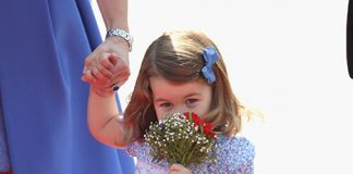Princess Charlotte looked delighted with her flowers Photo C GETTY IMAGES