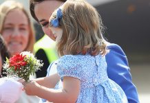 Princess Charlotte takes her royal duties seriously with first diplomatic handshake in Berlin Photo (C) GETTY IMAGES
