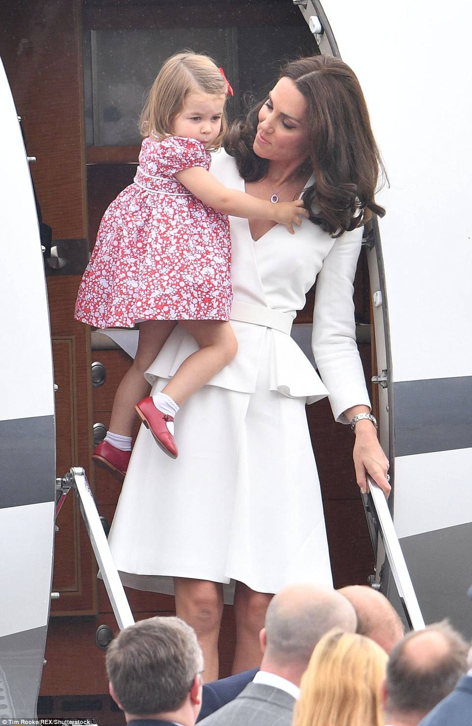 Princess Charlotte was pretty as a picture in a floral dress with adorable red shoes and white socks