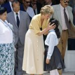 Princess Diana embraces ten year old Heba Salah during a visit to The Institute For Polio Rehabilitation in Cairo in 1992 1