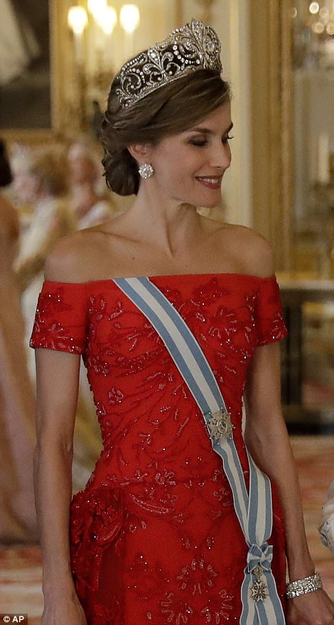 Queen Letizia plumped for her country's national colour and stunned in a bejewelled red gown, which accentuated her curves