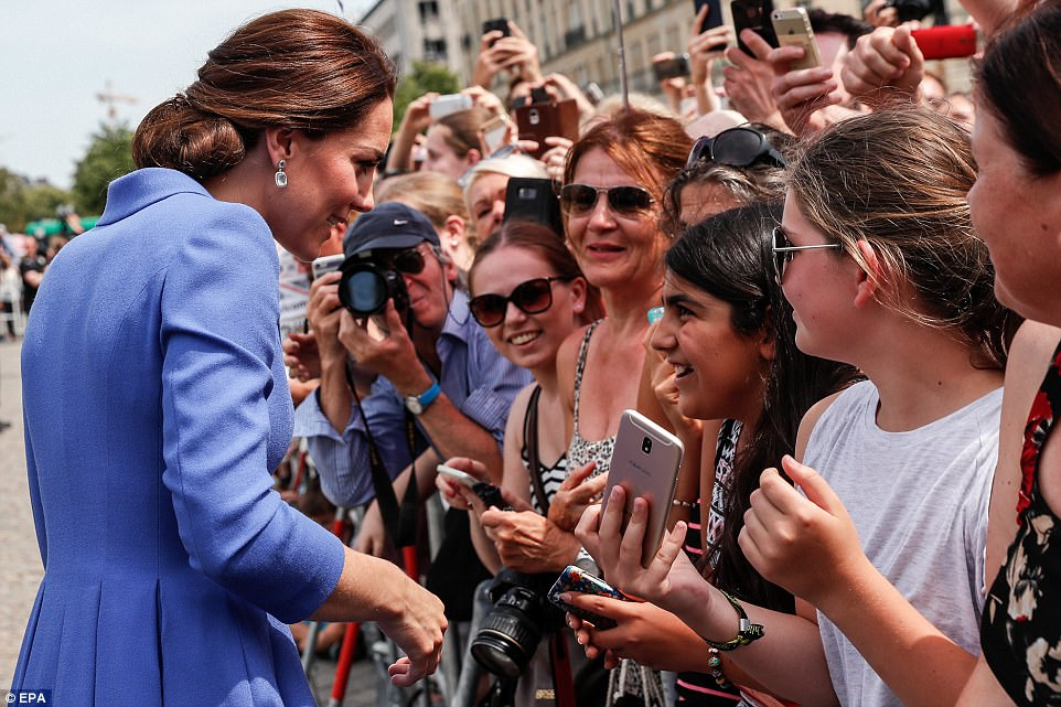 Royal fans had their cameras at the ready, eager to get a snap of the Duchess of Cambridge
