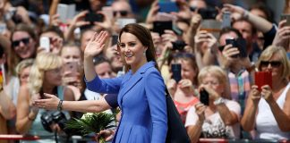Royal fever! Crowds waves and take photos as Kate makes her way to the Brandenburg Gate, accompanied by Private Secretary Rebecca Deacon