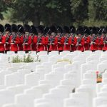 Servicemen march through the Commonwealth War Graves Commisionss Tyne Cot Cemetery ahead of a ceremony attended by Prince Charles