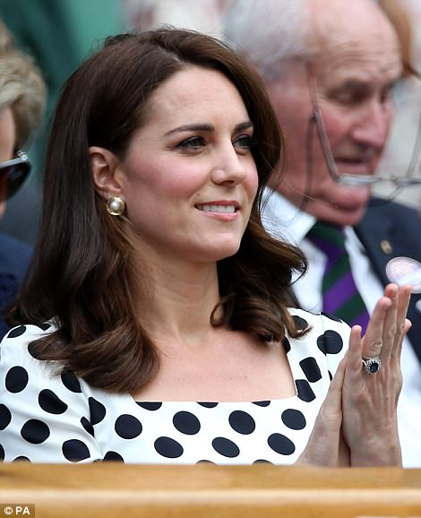 She accessorised today with gold and pearl earrings by Oscar De La Renta