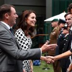 Smiling Kate is introduced to servicemen and women on day one of the Wimbledon Championships