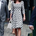 The Duchess arrived at the SW19 grounds this morning in a polka dot dress by Dolce Gabbana toting a white Victoria Beckham handbag