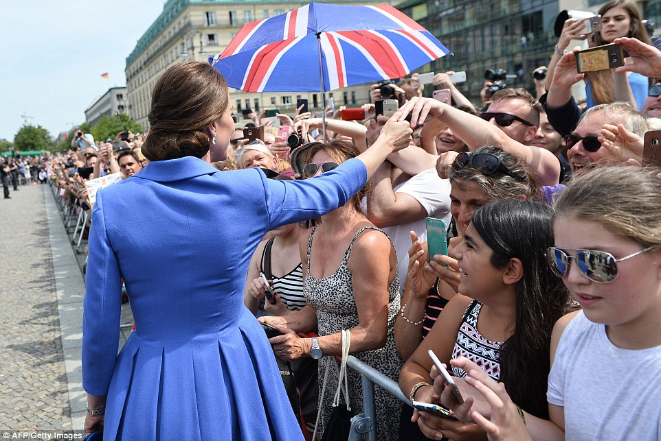The Duchess did her utmost to shake hands with as many spectators as possible as she made her way through the crowd