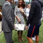 The Duchess experienced a fit of the giggles as she and Philip Brook left chatted to world number eight Dominic Thiem