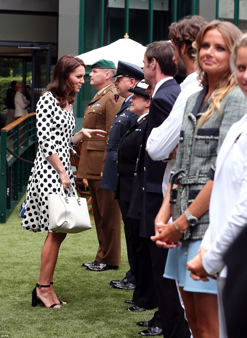 The Duchess is spending time meeting people who carry out essential behind-the-scenes work at Wimbledon, before watching Andy Murray on Centre Court