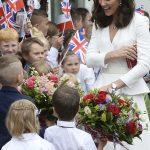 The Duchess looked delighted to be introduced to some young royal fans after lunch at the presidential palace