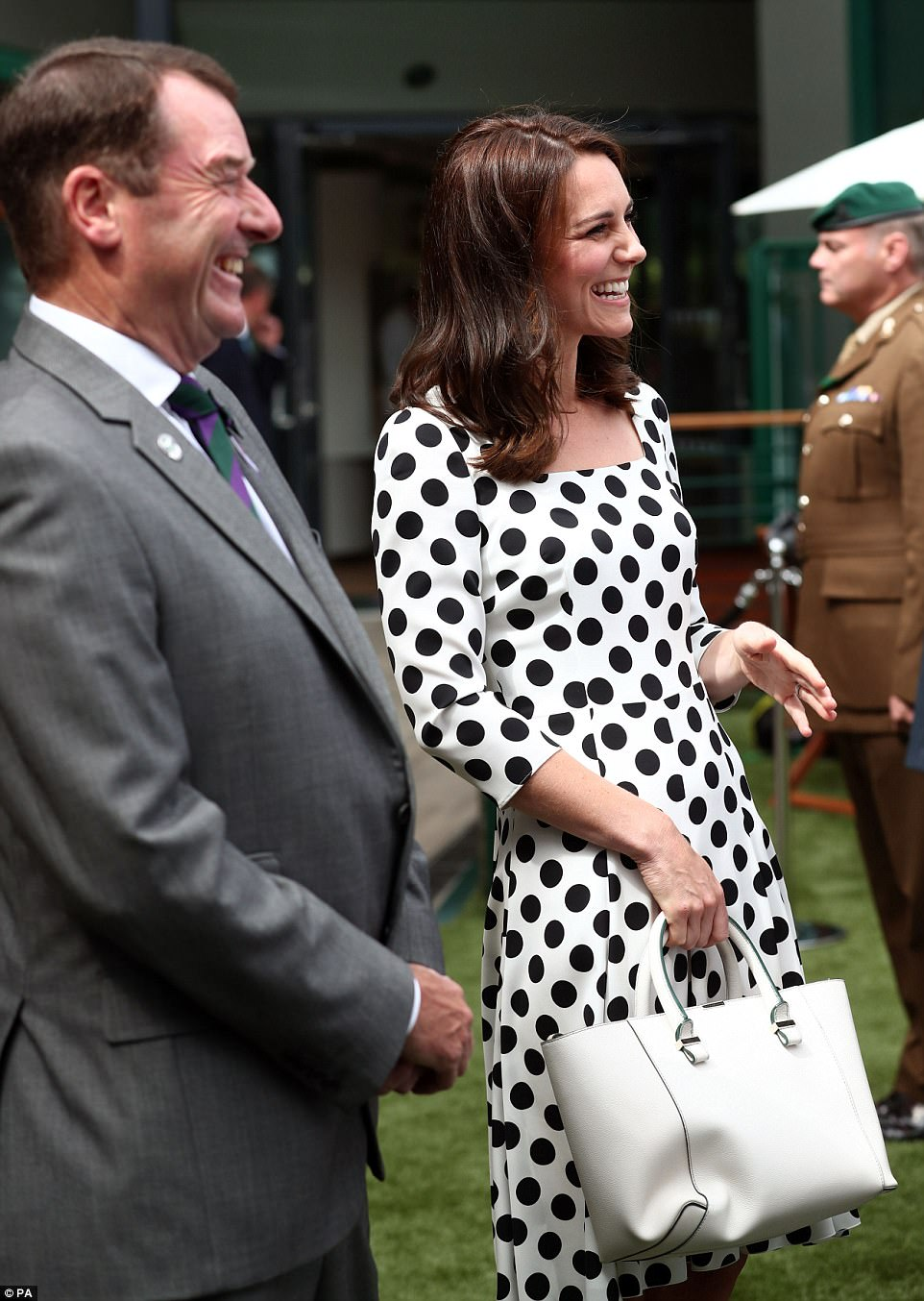 The Duchess of Cambridge, an avid tennis fan, was in great spirits as she chatted to service personnel at Wimbledon this morning head of Andy Murray's match