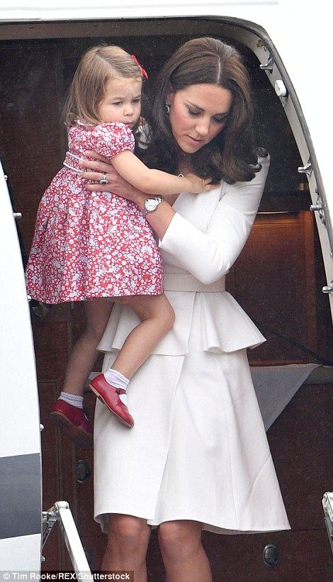 The Duchess of Cambridge carried her two-year-old daughter from the plane and down the steps (left). Charlotte was looking adorable in a red and white floral patterned dress