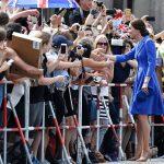 The Duchess of Cambridge greets spaectators near Berlins most iconic landmark the Brandenburg Gate