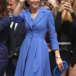 The Duchess of Cambridge was impeccably co ordinated carrying a small ruched blue clutch bag to match her outfit