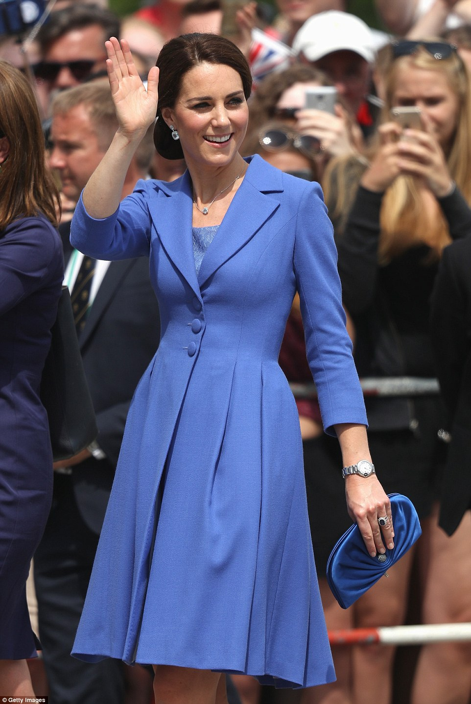 The Duchess of Cambridge was impeccably co-ordinated, carrying a small ruched blue clutch bag to match her outfit