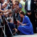 The Duchess shares a sweet moment with two young boys who had waited to greet her near the Brandenburg Gate