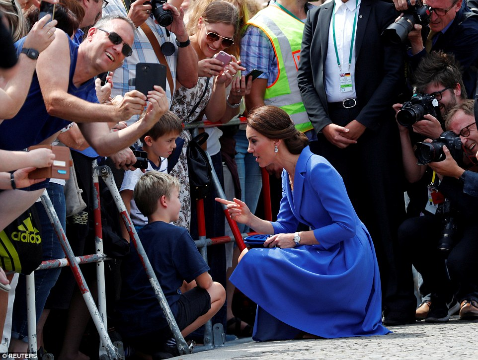 The Duchess shares a sweet moment with two young boys, who had waited to greet her near the Brandenburg Gate