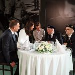 The Duchess speaks to World War II veterans during a visit to the Warsaw Rising Museum in Warsaw