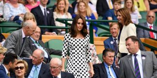 The Duchess takes her seat in prime position in the royal box on Centre Court ahead of Andy Murrays first round bout