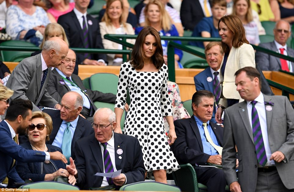 The Duchess takes her seat in prime position in the royal box on Centre Court ahead of Andy Murray's first round bout