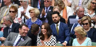 The Duchess was in prime position between Philip Brook chairman of the All England Lawn Tennis Club and his wife Gill