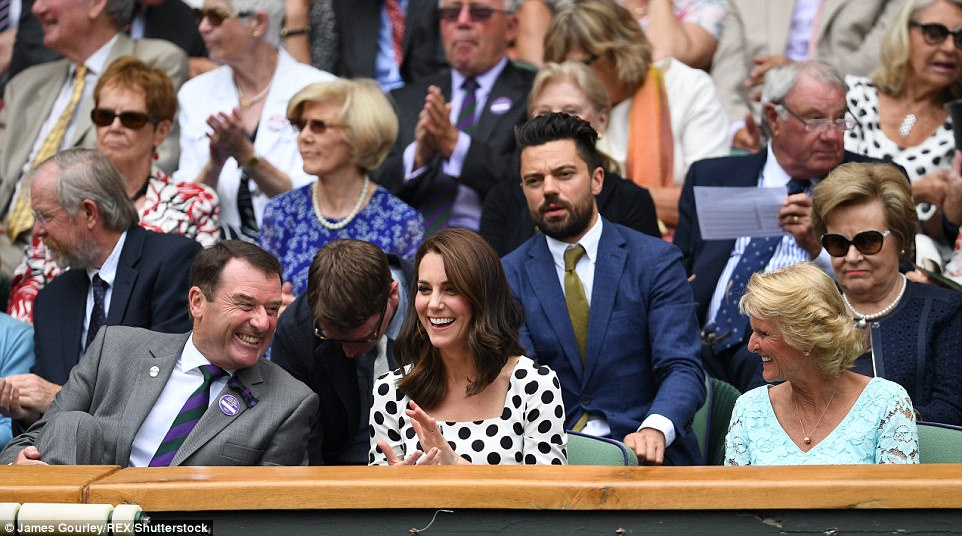 The Duchess was in prime position between Philip Brook, chairman of the All England Lawn Tennis Club and his wife Gill