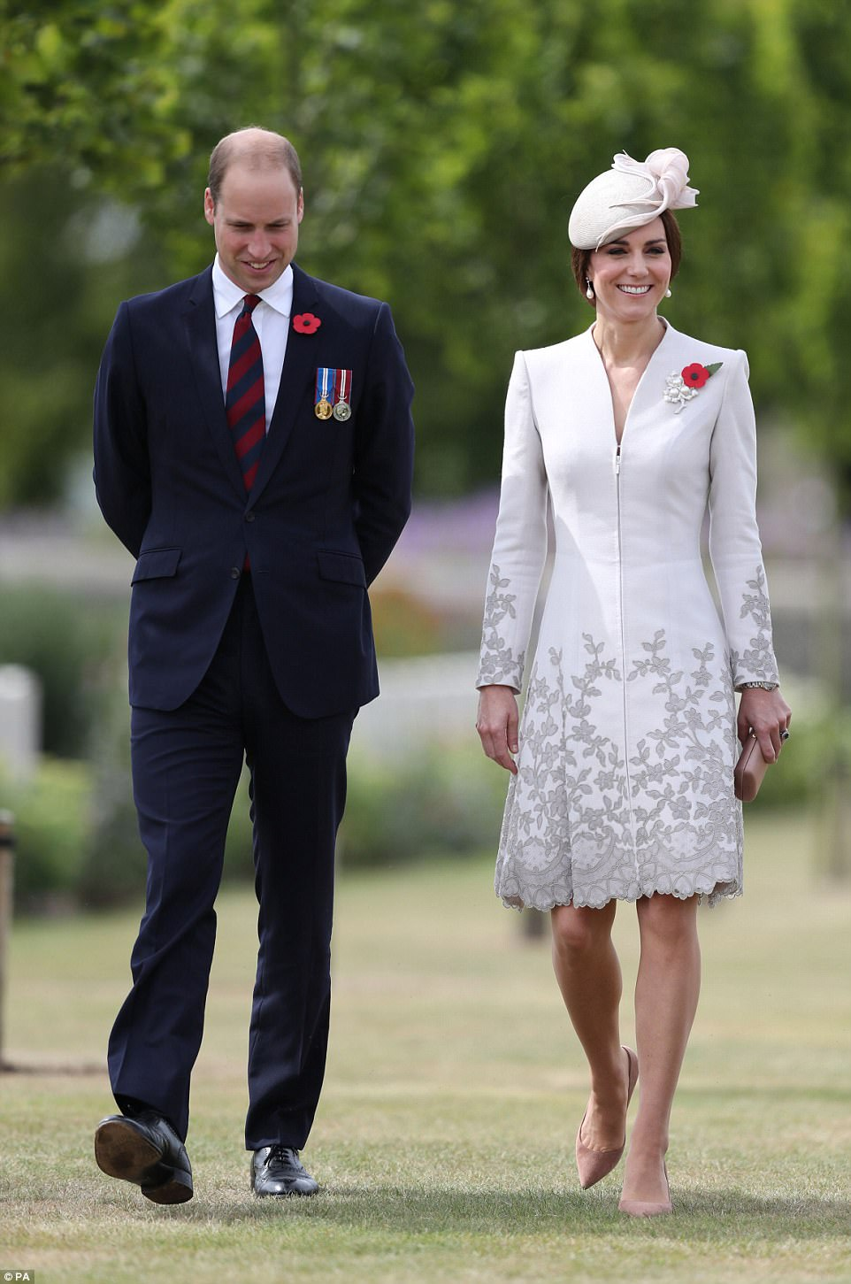 The Duchess wore a poppy and a diamond and pearl leaf brooch, on her pale grey Catherine Walker coat